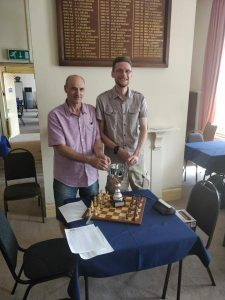 Hammersmith chairperson Bajrush Kelmendi, Cork Chairperson Mark Watkins, and the trophy